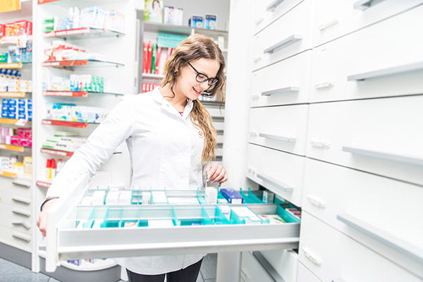 women looking in draw for medicine. Pharmacy School Outlook for young pharmacists